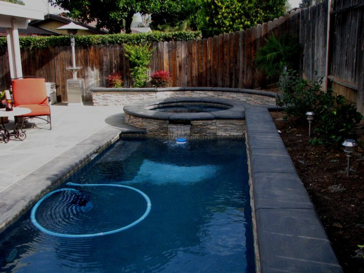 Endless and lap pools on pinterest endless pools lap for Small backyard designs with pool
